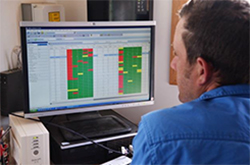 A farmer reviews the AMS software