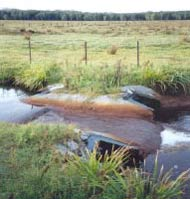 Figure 4. A weir used to contain acid groundwater