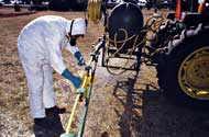 Man calibrating a sprayer