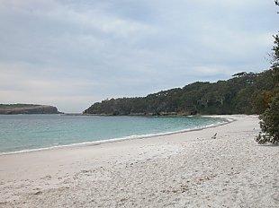Beach adjoining a rocky shore on the headland