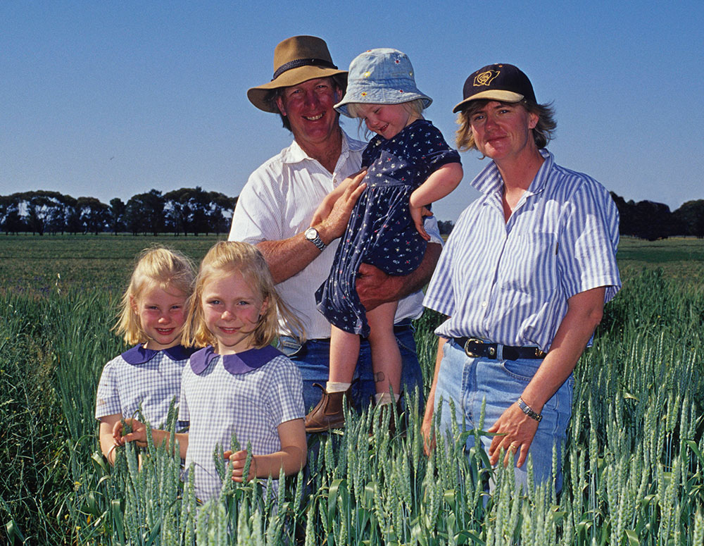 A farming family standing in their paddock