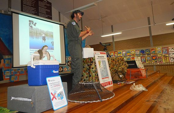 Fisheries Officer in a room speaking at an information session (NSW North Coast)