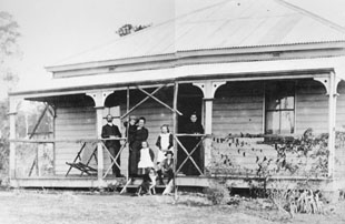 GM McKeown and family standing on the verandah of the Manager's Cottage of Wollongbar Experimental Farm c 1896
