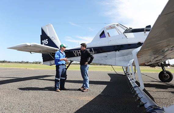 Pilot Dave McAnally and Minister for Primary Industries, Steve Whan, discuss aerial spraying plans in Bourke