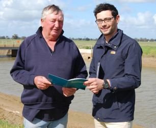 Bill and Patrick are near Deniliquin holding a the bird management guide and discussing strategies