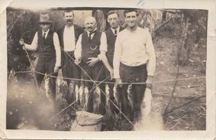 Tramworkers with their catch