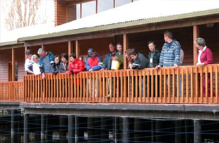 Visitors at the Visitor Centre viewing pond