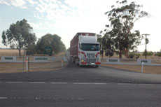 Farewell Trangie ... the truck pulls on to the Mitchell Highway from Trangie Agricultural Research Centre.