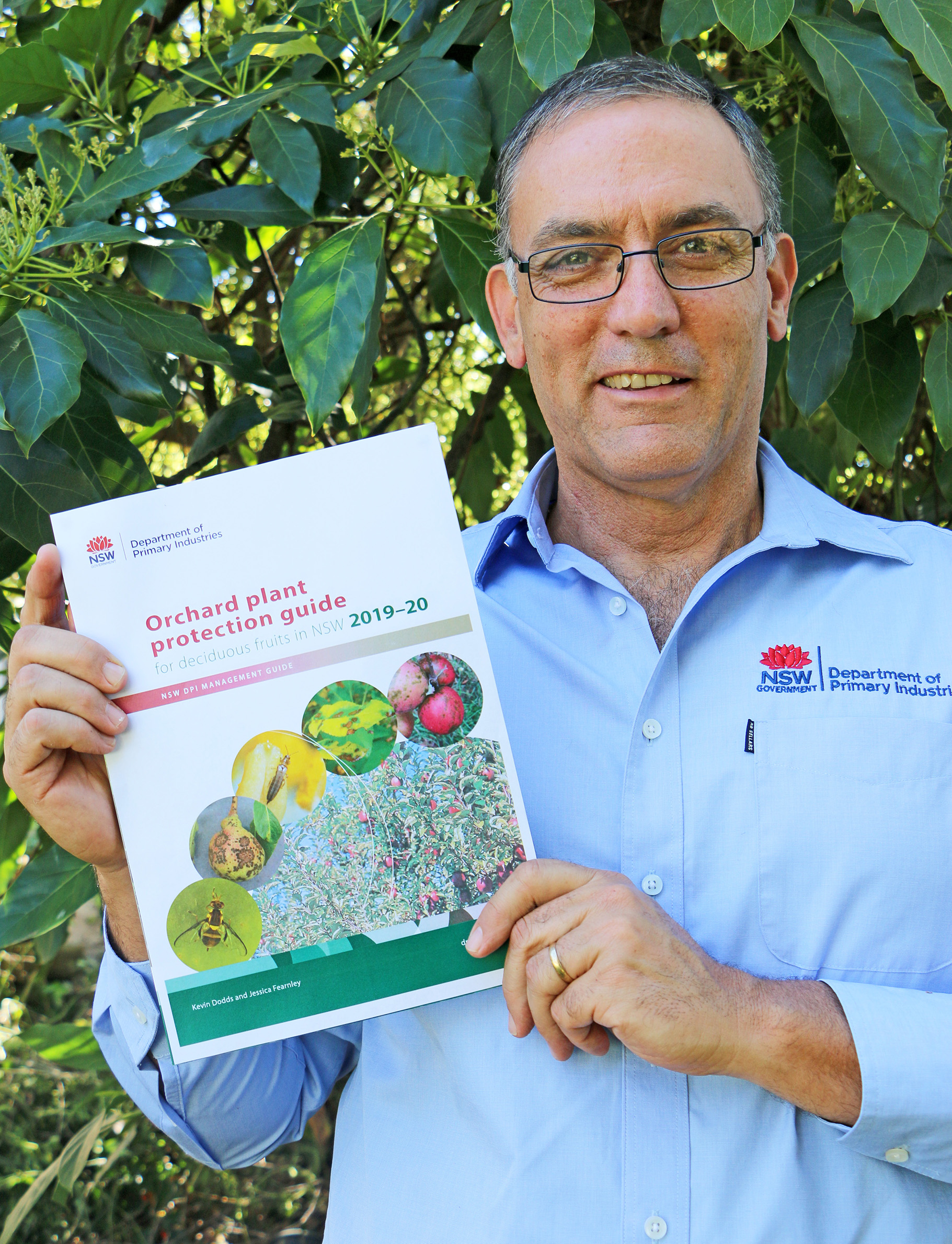 Kevin Dodds holding the Orchard Plant Protection Guide