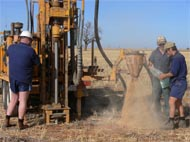 Drilling crew collecting deep soil samples so that they can be tested for soil chloride concentration.