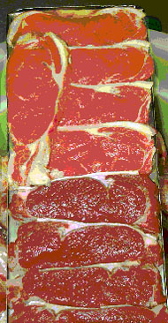 Rib-eye steaks with darker, high pH product at bottom; bright coloured, normal pH (5.5) at top.