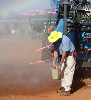 Steven Falivene (NSW DPI Citrus Development Officer) conducting a nozzle output test.