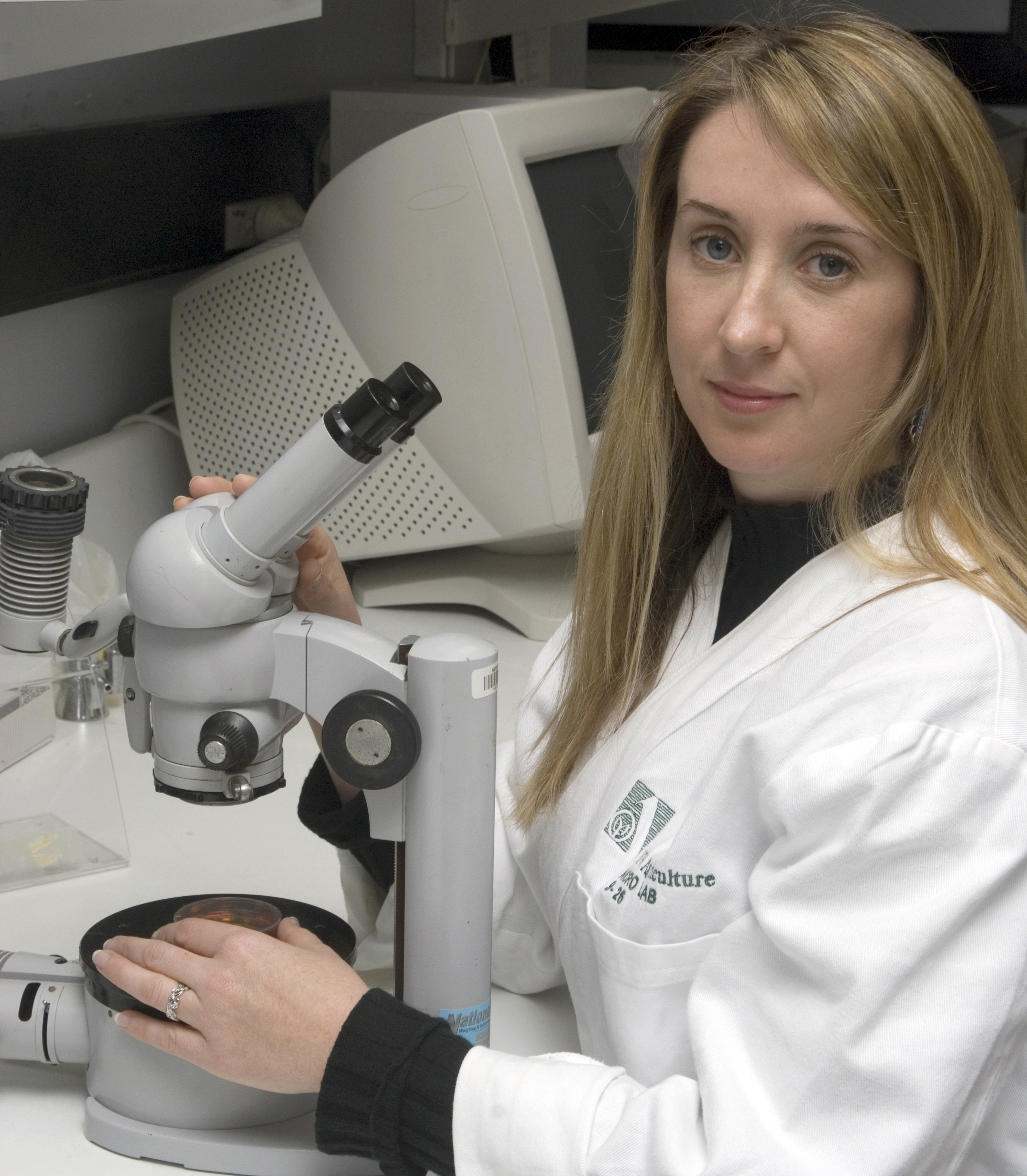 Dr Cheryl Jenkins with microscope