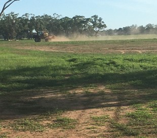 """""""Filed with tractor and spray rig applying herbicide"""