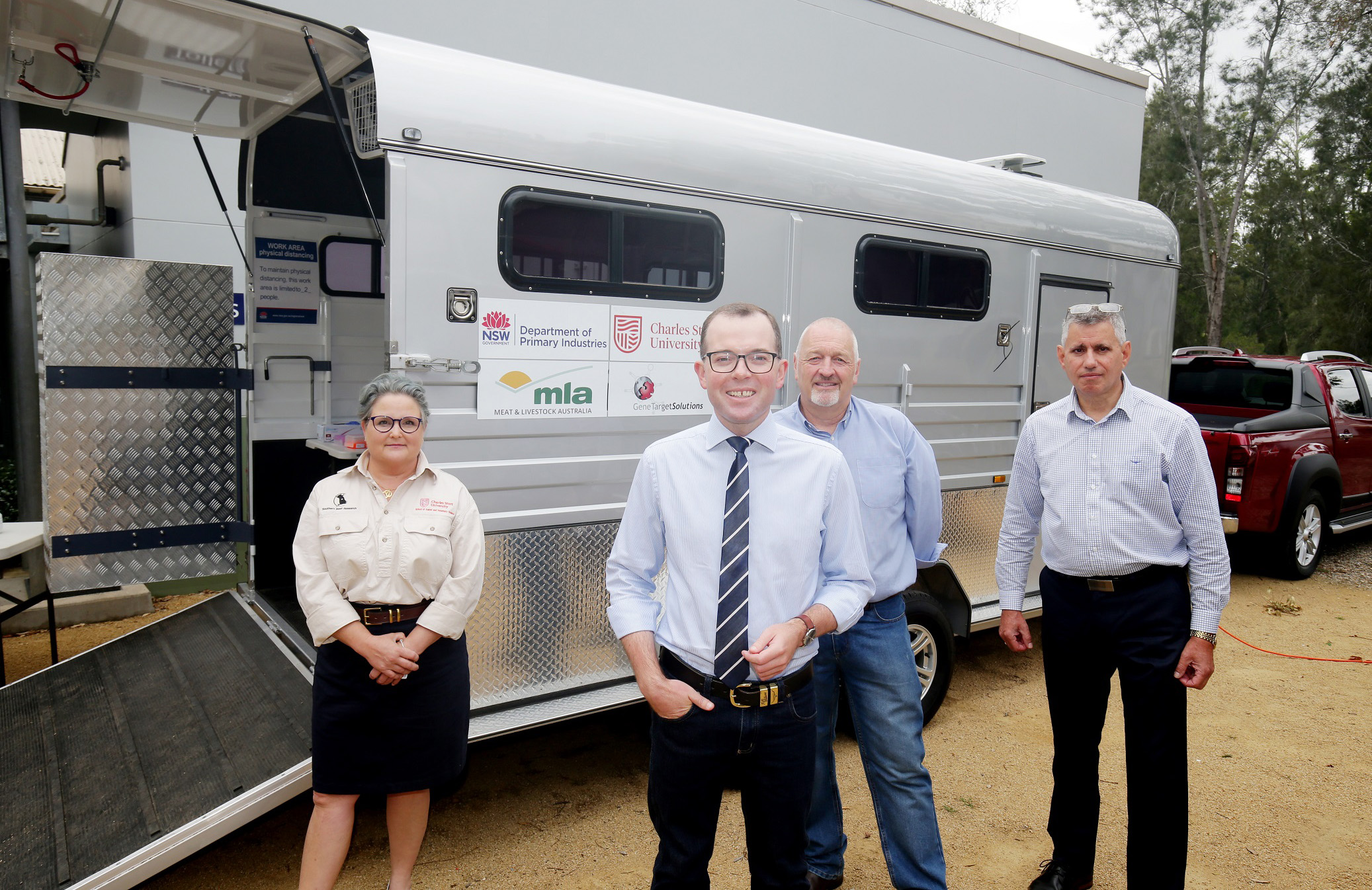 Minister Adam Marsh, Dr Jane Quinn, Dr Ian Marsh and Andrew Szentirmay with the mobile testing laboratory