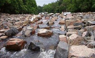 River rushes through rock pathways allowing fish to progress