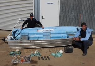 Fisheries Officers display the seized goods