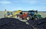 Loading organic fertiliser