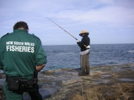 Fisheries Officer conducts compliance check on a rock fisher