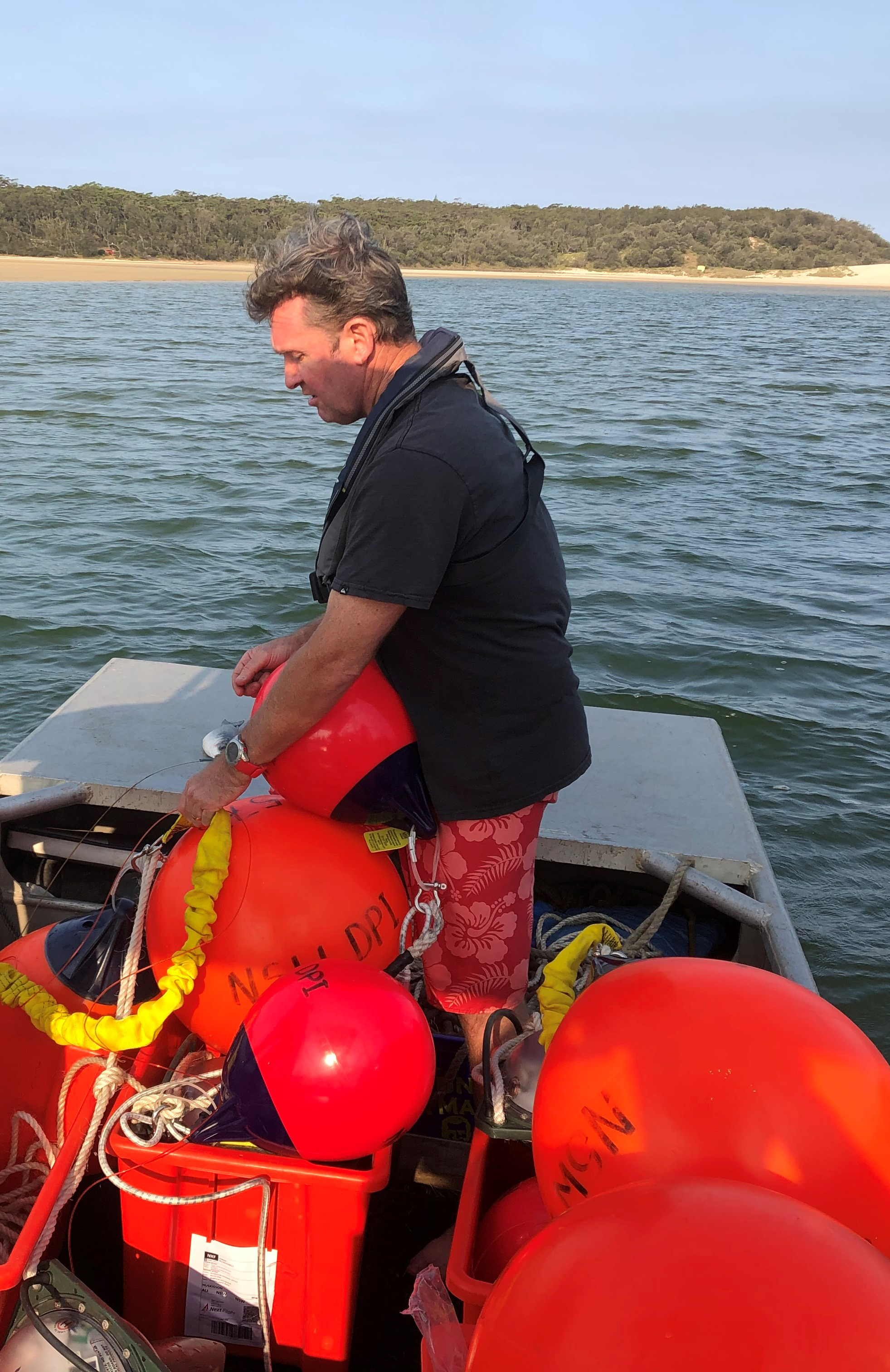 Marcel Green from DPI Fisheries deploying SMART drumlines in Lake Conjola, NSW