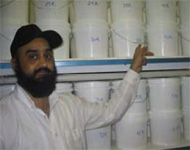 Research Scientist Dr Bhupinderpal Singh with a range of biochars stored in sealed buckets. The biochars are being used in a laboratory incubation experiment to study the turnover of various biochars applied to soil.