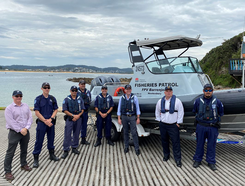 Minister for Agriculture Adam Marshall (middle) pictured with Member for Terrigal Adam Crouch MP and Fisheries Officers at Terrigal boat ramp.